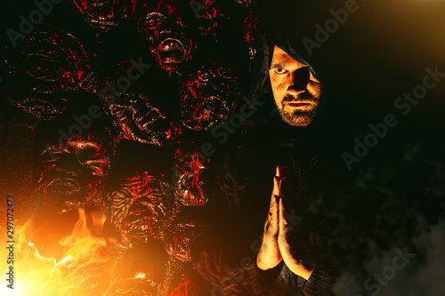 Fotografia Praying monk near the wall with bloody faces.