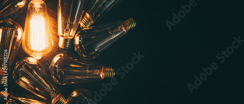 Fotografie, Tablou Glowing bulb. Idea, uniqueness, leadership and different concept.