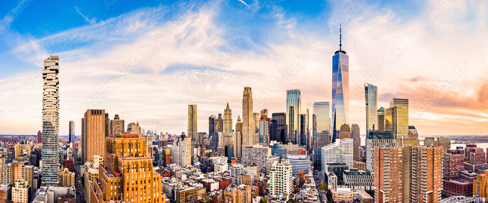 Aerial panorama of Lower Manhattan skyline at sunset viewed from above Greenwich street in Tribeca neighborhood.