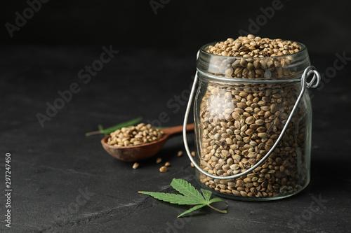 Canvas Print Organic hemp seeds and leaf on black table