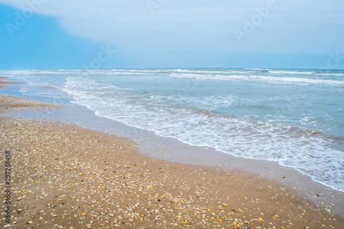 A beautiful soft and fine sandy beach along the gulf coast of South Padre Island Fototapeta