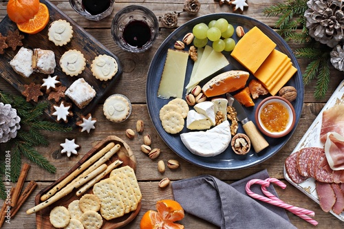 Carta da parati Festive winter appetizers table with various of cheese, curred meat, sweets, nuts and fruits