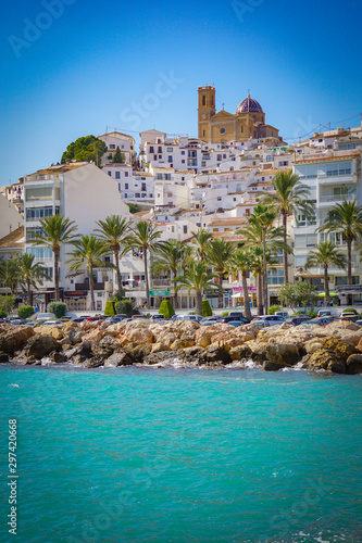 ALTEA, SPAIN - OCTOBER 4, 2019: Beautiful houses in Altea with tourist attractions and turquoise sea