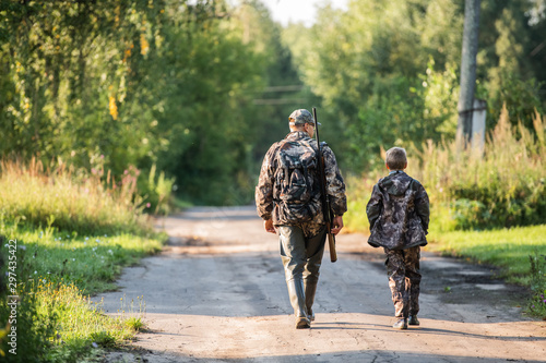 father pointing and guiding son on first deer hunt Poster Mural XXL