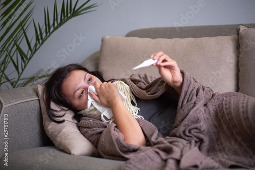 Photo Ill upset woman blowing running nose got flu caught cold sneezing in tissue sit