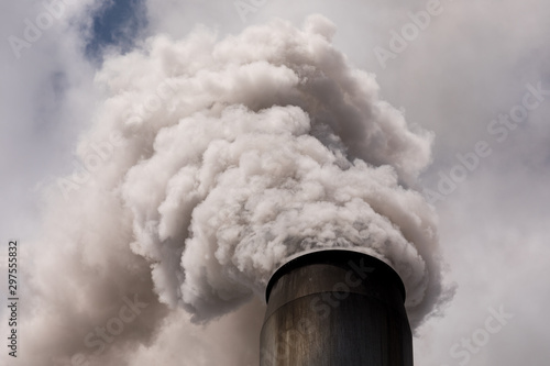 Photo smoke stack billowing smoke