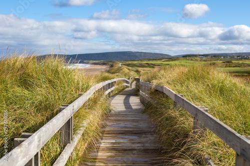 Fotomural Wood boardwalk at Inverness Beach on Cape Breton Island, Nova Scotia, Canada on autumn day
