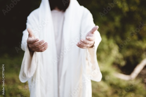 Closeup of Jesus Christ reaching out with a blurred background Fototapeta