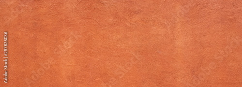 Fotografia Abstract panorama image of Orange clay wall grunge texture background for interior decoration