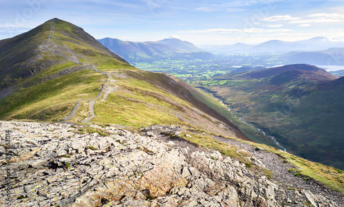 Fotografie, Obraz The rugged path from the summit of Hobcarton with Grisedale Pike in the distance and the valley of Coledale Beck far below, the Lake District, England, UK