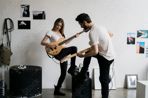 Young couple playing together in the recording studio