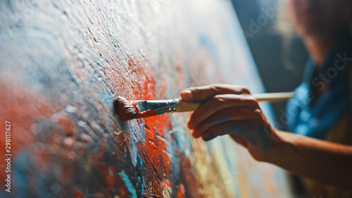 Fotografie, Obraz Female Artist Works on Abstract Oil Painting, Moving Paint Brush Energetically She Creates Modern Masterpiece
