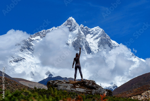 Stampa su Tela Active hiker hiking, enjoying the view, looking at mount Everest landscape
