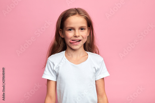 crazy funny little girl shows off her tongue Fototapeta