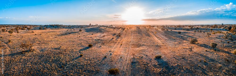 Sunrise over Australian desert - wide aerial panoramic landscape