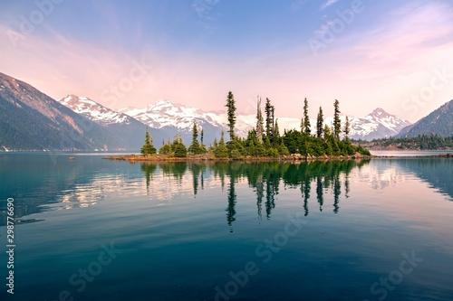 Canvas Print Battleship Island with Pine Trees reflected in calm water of Garibaldi Lake Land