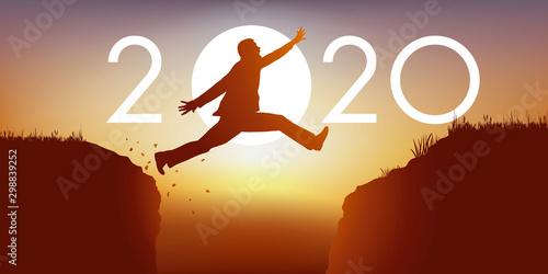 Canvastavla Un homme saute par dessus un gouffre entre deux falaises devant un soleil au zen