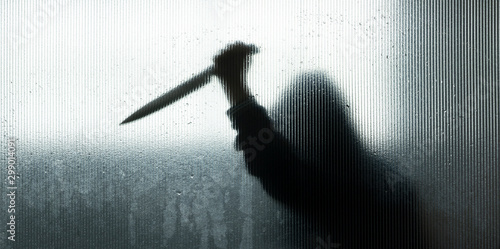 Canvas-taulu shadow of hand holding big sharp knife behind Frosted glass in the bathroom background