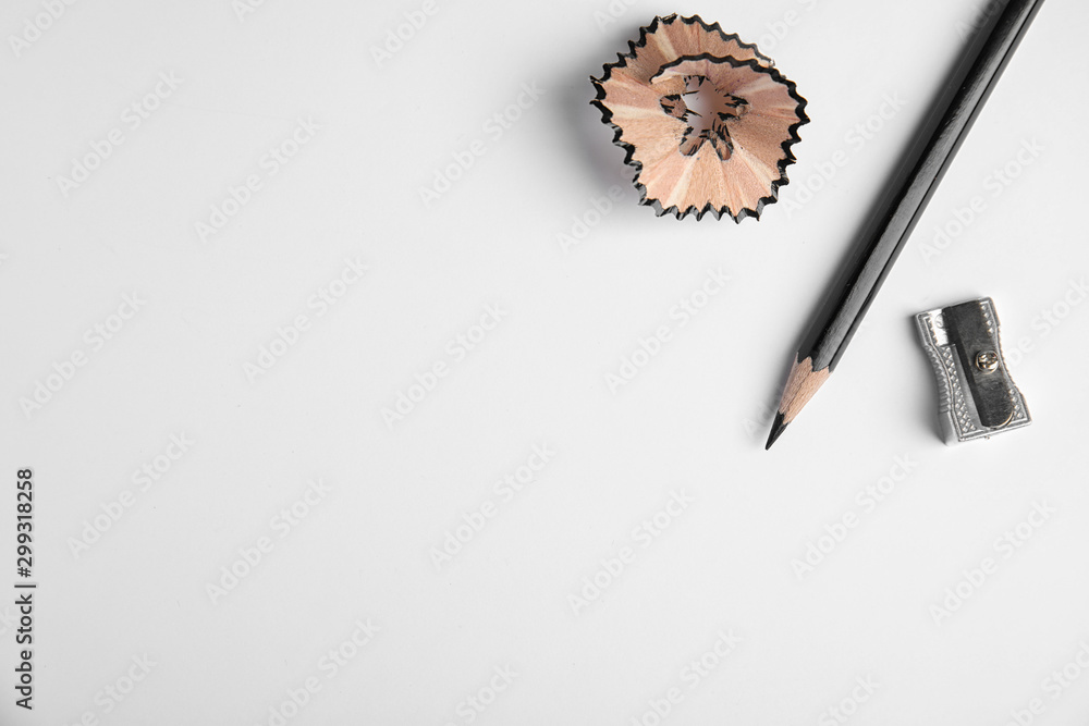 Pencil, sharpener and shaving on white background, top view <span>plik: #299318258 | autor: New Africa</span>