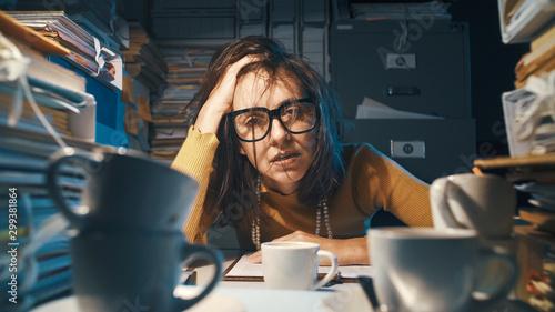 Fotografija Stressed exhausted businesswoman working at night