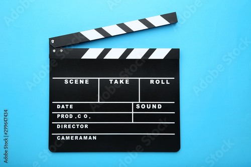 Photo Clapper board on blue background