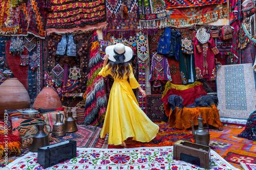 Fotomural Beautiful girl at traditional carpet shop in Goreme city, Cappadocia in Turkey