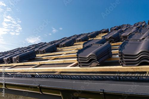Roof ceramic tile arranged in packets on the roof on roof battens Fototapeta