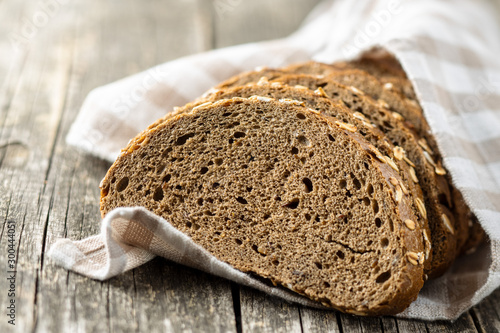 Cuadros en Lienzo Sliced whole grain bread with oat flakes. Wholemeal bread.