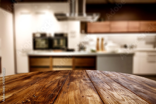 Fotografia Wooden table background of free space for your decoration and blurred background of kitchen