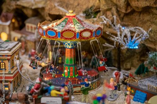 Carta da parati Amusement park in miniature with carousels in winter