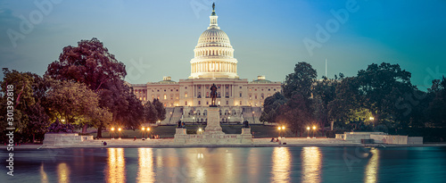 Fotografiet Panorama of the Capitol of the Unites States in evening light with the Capitol Reflecting Pool in the foreground