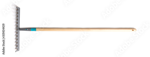Fotografia Rake with a wood handle isolated over a white background