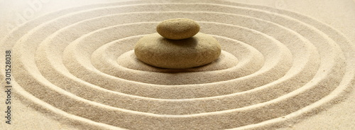 Obraz na płótnie zen garden meditation stone background with stones and lines in sand for relaxat