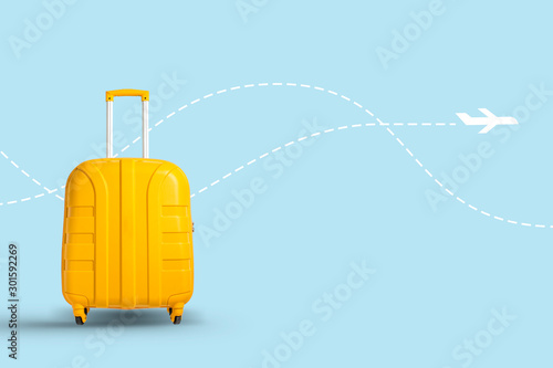 Fotografia Yellow suitcase on a white background with a flying airplane icon