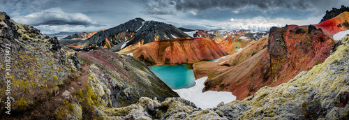 Fotomural Panoramic view of colorful rhyolite volcanic mountains Landmannalaugar as pure w
