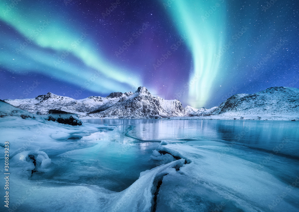 Aurora Borealis, Lofoten islands, Norway. Nothen light, mountains and frozen ocean. Winter landscape at the night time. Norway travel - image