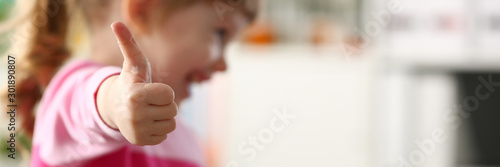Little girl show approve or OK sign with her arm