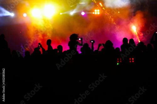 Fotografija crowd of people at night open air festival