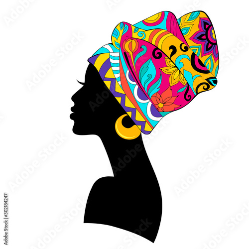 Fotografie, Obraz African Woman silhouette with bright multicoloured Turban isolated on white back