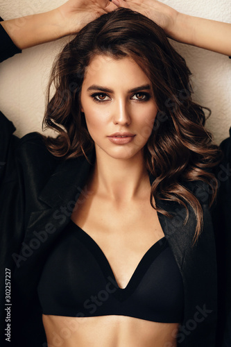 Fotomural beautiful sexy woman in elegant clothes posing in studio