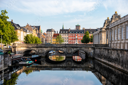 Copenhagen, Denmark. View of old Marmorbroen or Marble bridge with the reflection. The historical center of the Danish capital.