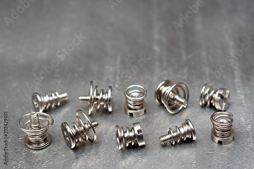 Valokuvatapetti Spring loaded screws on metal plate