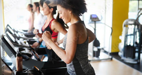 Fotografie, Obraz Group of people exercising in a gym cardio training and running