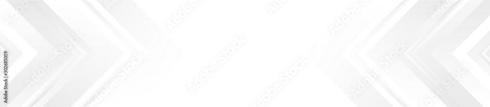 Projekt transparentu technologii z białymi i szarymi strzałkami. Streszczenie tło geometryczne <span>plik: #302685059 | autor: saicle</span>