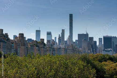 New York skyscrapers over Central Park trees Fotobehang