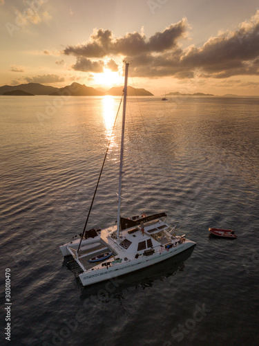 Beautiful view to catamaran boat in Seychelles bay during sunset from a drone, t Fototapeta