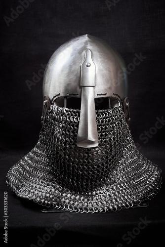 Murais de parede Knight helmet on a black background. Front view.