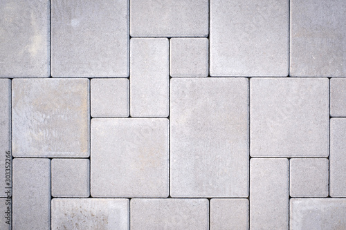 Wallpaper Mural Laying gray concrete paving stones on house courtyard