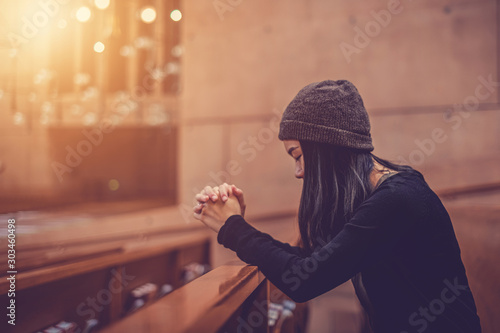 Leinwand Poster Close up prayer's hand pray in church, Young woman pray to God, with blank copy