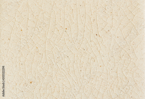 Fotomural background and texture of stretch marks cracked on white cream glazed tile